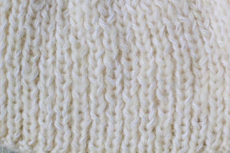 Sweater or scarf Pattern Of White Knitted Fabric Texture Background royalty free stock images