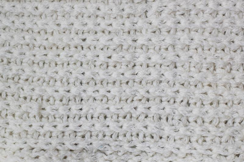 Sweater or scarf Pattern Of White Knitted Fabric Texture Background royalty free stock photography
