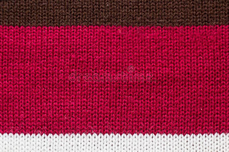 Sweater thread texture background ,Multicolor front loops of wool yarn knitted background stock photos