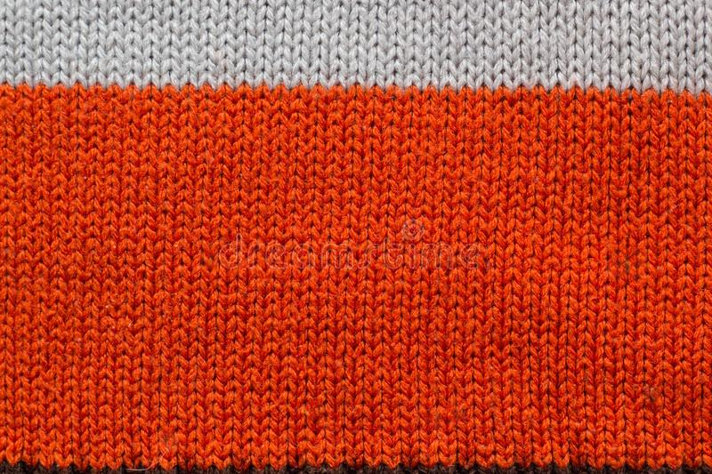 Sweater thread texture background ,Multicolor front loops of wool yarn knitted background stock photo