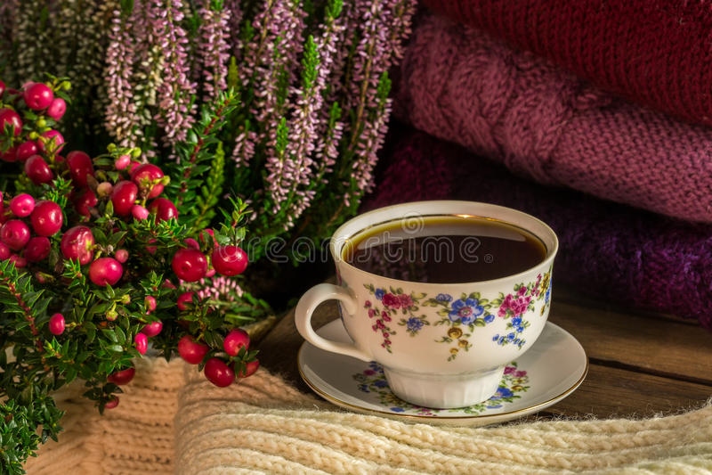 Sweaters and a cup of coffee stock images