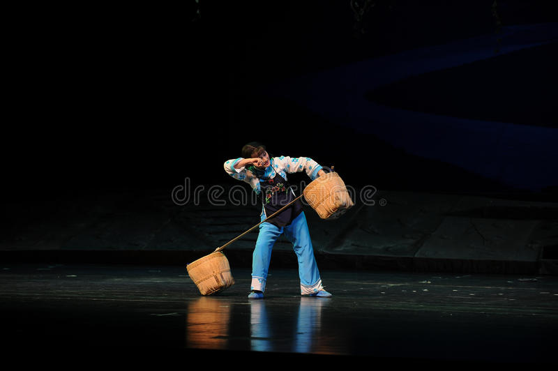 Sweating- Jiangxi opera a steelyard. Jiangxi opera a steelyard is adapted from a true story: the last century fortys, the protagonists father runs an oil mill in royalty free stock photos