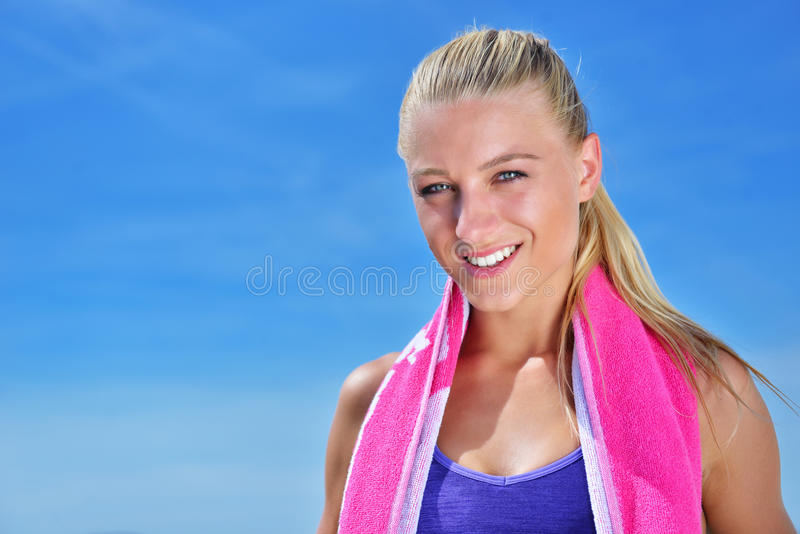 Sweaty fitness woman tired after training. Caucasian female athlete sweating and exhausted after exercising on sky copy space background stock photos