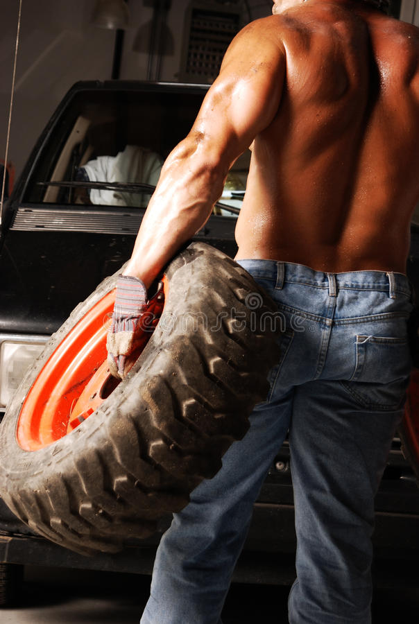 Sweaty Mechanic Back Stock Image