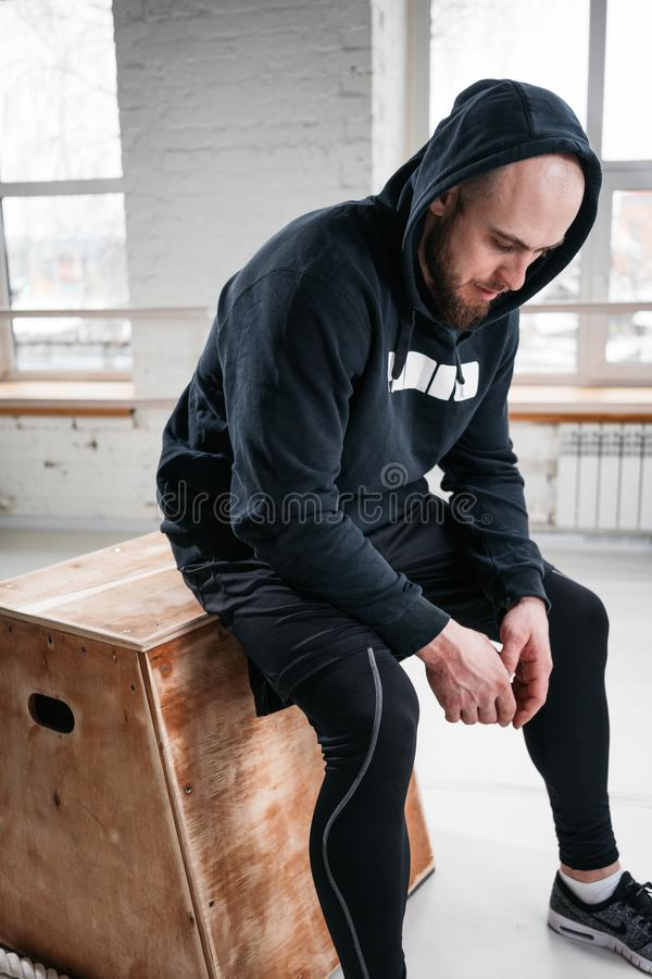 Sweaty strong man relaxing after his hard training royalty free stock image