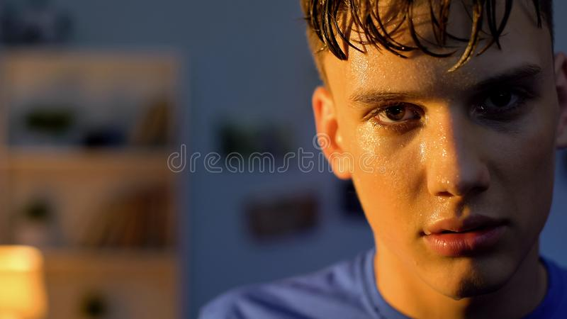 Sweaty teen looking to camera after workout, overcoming difficulties concept royalty free stock photography