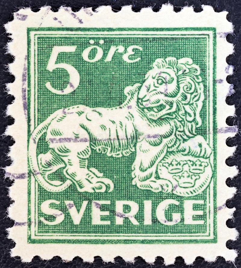 SWEDEN - CIRCA 1920: A stamp printed in Sweden shows a lion after sculpture by B. Foucquet , circa 1920. SWEDEN - CIRCA 1920: A stamp printed in Sweden shows a royalty free stock photos