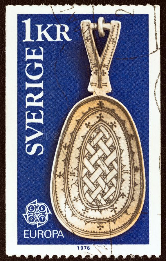 SWEDEN - CIRCA 1976: A stamp printed in Sweden shows a Lapp Spoon, circa 1976. SWEDEN - CIRCA 1976: A stamp printed in Sweden from the `Europa. Handicrafts` royalty free stock image