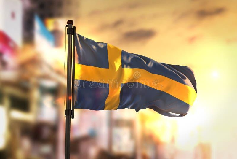 Sweden Flag Against City Blurred Background At Sunrise Backlight royalty free stock image