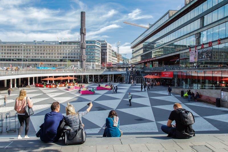 SWEDEN STOCKHOLM,  SEPTEMBER 1, 2016: tourists make selfie at Sergels torg. Sergels torg general square of Stockholm. In center st. Ands 38-meter glass column stock image