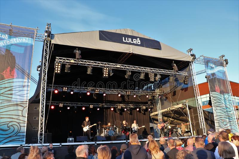 Swedish artist Louise Hoffsten with band at Luleå Harbor Festival. The swedish artist Louise Hoffsten with her band a sunny July evening at Luleå Harbor royalty free stock images