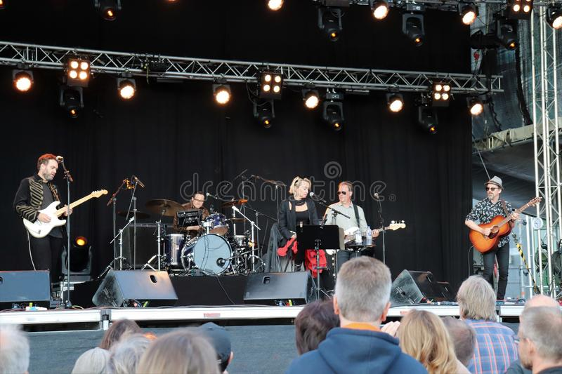 Swedish artist Louise Hoffsten with band at Luleå Harbor Festival. The swedish artist Louise Hoffsten with her band a sunny July evening at Luleå  Harbor royalty free stock image