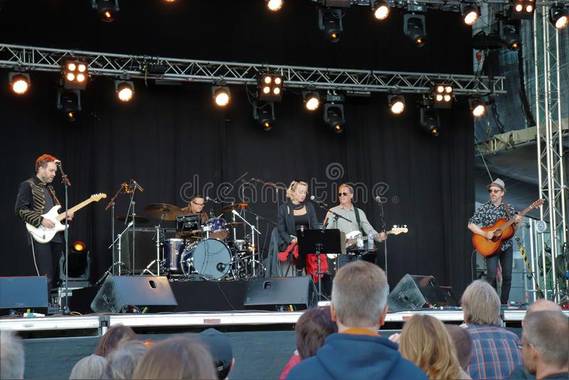 Swedish artist Louise Hoffsten with band at Luleå Harbor Festival. The swedish artist Louise Hoffsten with her band a sunny July evening at Luleå Harbor stock photos
