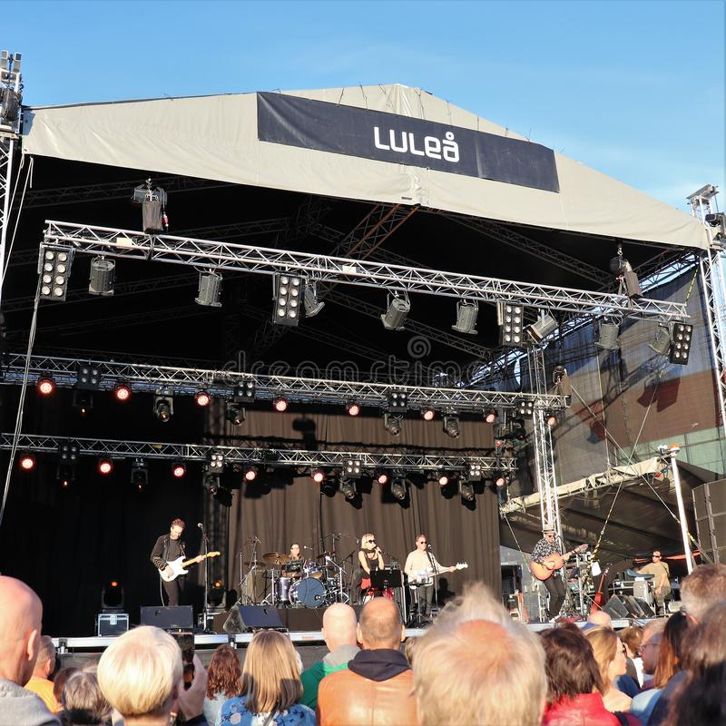 Swedish artist Louise Hoffsten with band at Luleå Harbor Festival. The swedish artist Louise Hoffsten with her band a sunny July evening at Luleå Harbor stock photo