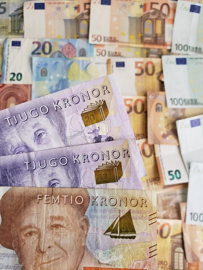 Swedish banknotes and euro bills. Europe, european, sek, sweden, kronor, crowns, commerce, exchange, travel, trade, trading, value, buy, sell, profit, price royalty free stock image