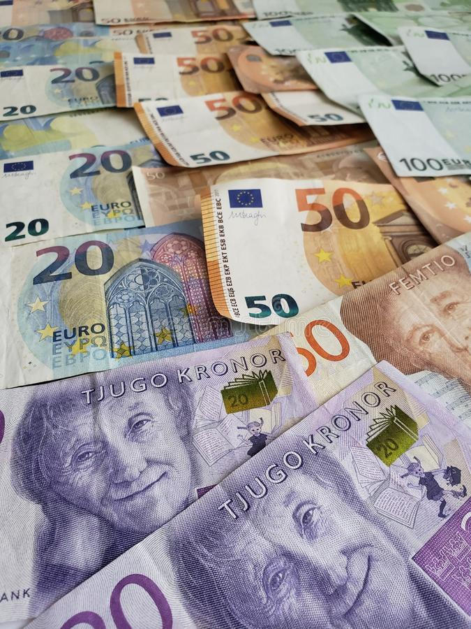 Swedish banknotes and euro bills. Europe, european, sek, sweden, kronor, crowns, commerce, exchange, travel, trade, trading, value, buy, sell, profit, price royalty free stock images