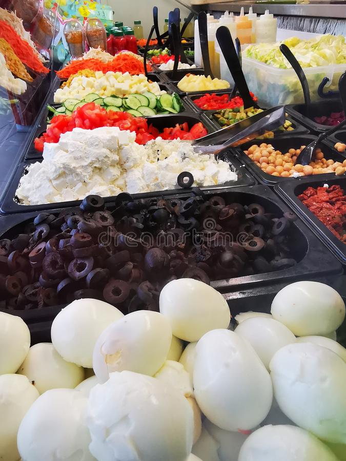 Swedish buffet - cooked eggs near olives and cheese stock images