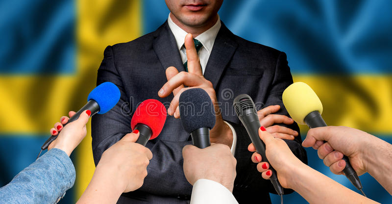 Swedish candidate speaks to reporters - journalism concept royalty free stock images