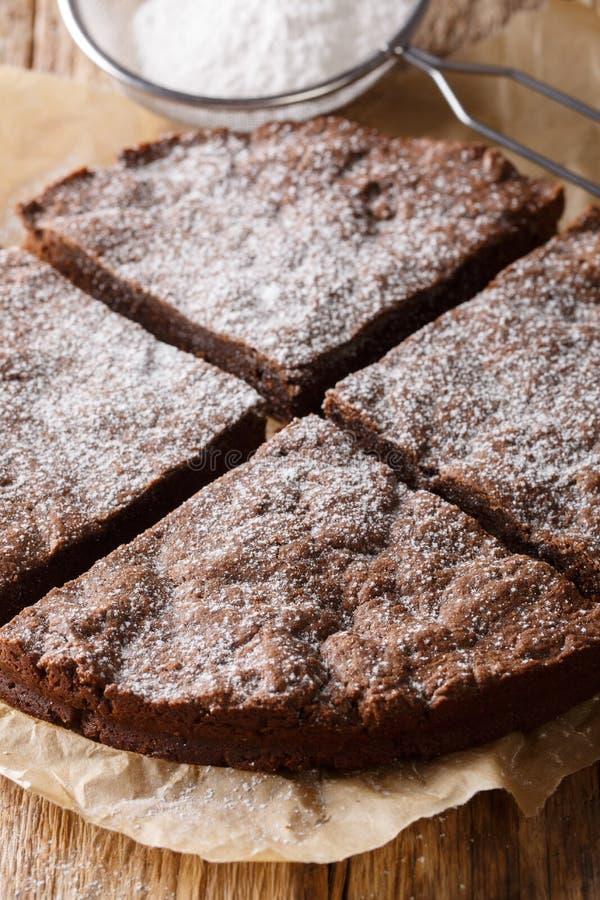 Swedish chocolate cake sprinkled with powdered sugar close-up. v stock photos