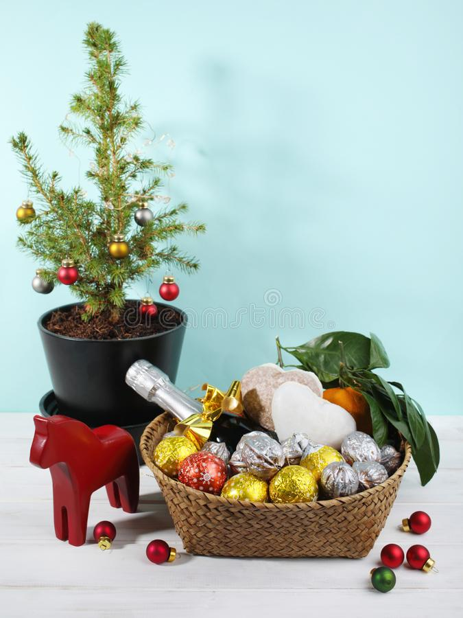 Swedish Christmas gift basket with sweets, fruits, and champagne stock image