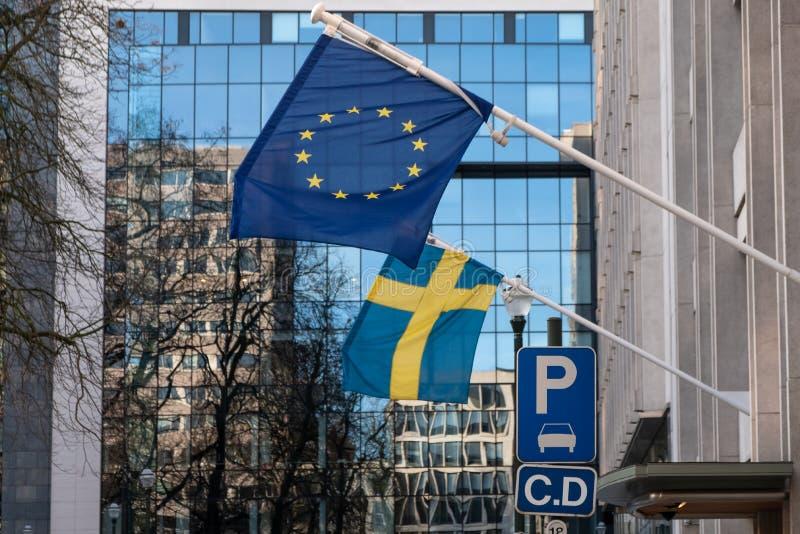 Swedish and European Union Flags. Swedish flag and European Union flags. Parking space for diplomatic corps stock image
