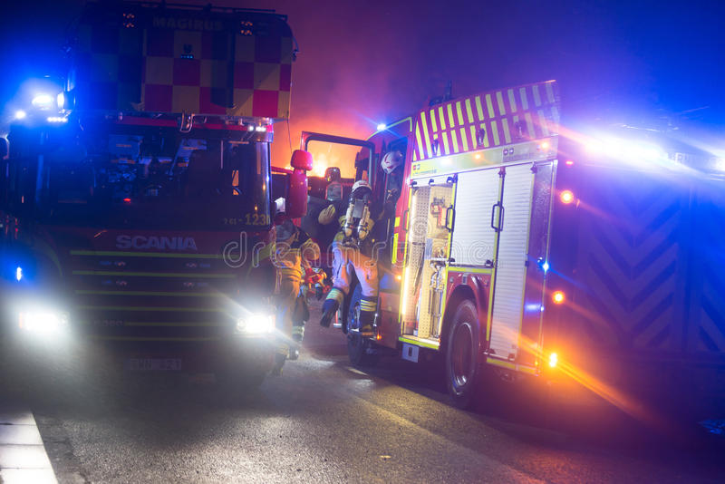 Swedish fire department. At burning house royalty free stock photo