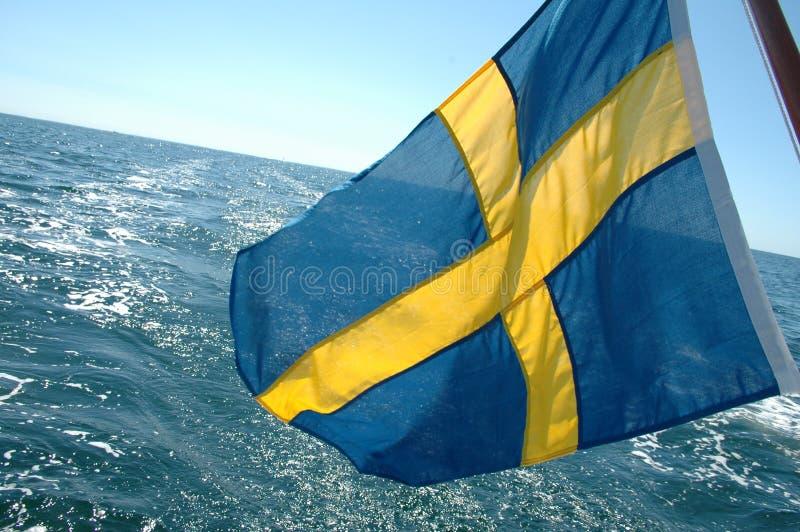 Swedish flag on open sea stock images
