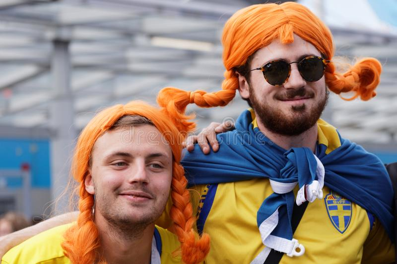 Swedish football fans in Saint Petersburg, Russia during FIFA World Cup 2018. St. Petersburg, Russia - July 3, 2018: Swedish football fans at Saint Petersburg stock images