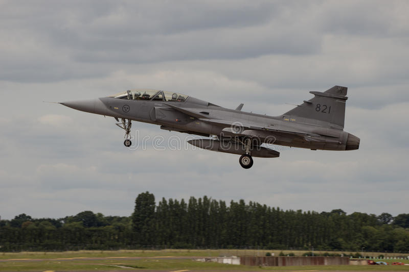 Swedish Gripen Landing at Air Tattoo. RAF FAIRFORD, UK - 6 JULY: A Swedish Air Force Gripen lands at The Royal International Air Tattoo on 6th July 2016 stock images
