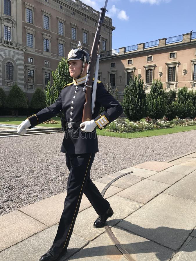 Swedish guardsman. Ceremonial guardsman on duty in the Swedish capital of Stockholm royalty free stock image
