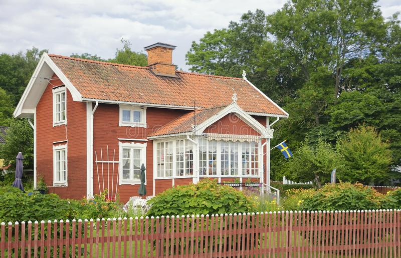 Swedish housing, old house with lovely garden. In summer stock images
