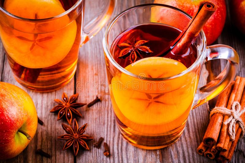 Swedish mulled wine with apple and christmas spices stock photos