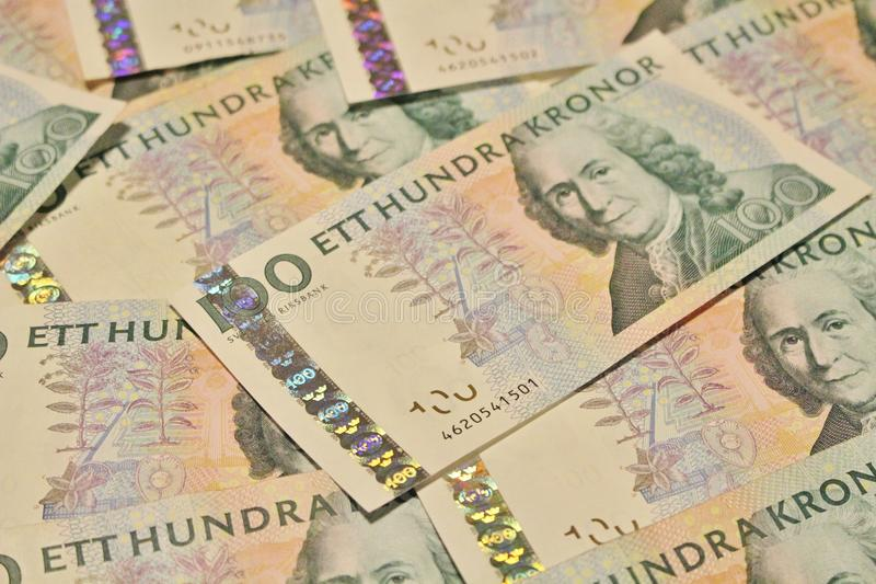 Swedish one hundred kronor banknotes. Many Swedish hundred kronor banknotes on a table stock images