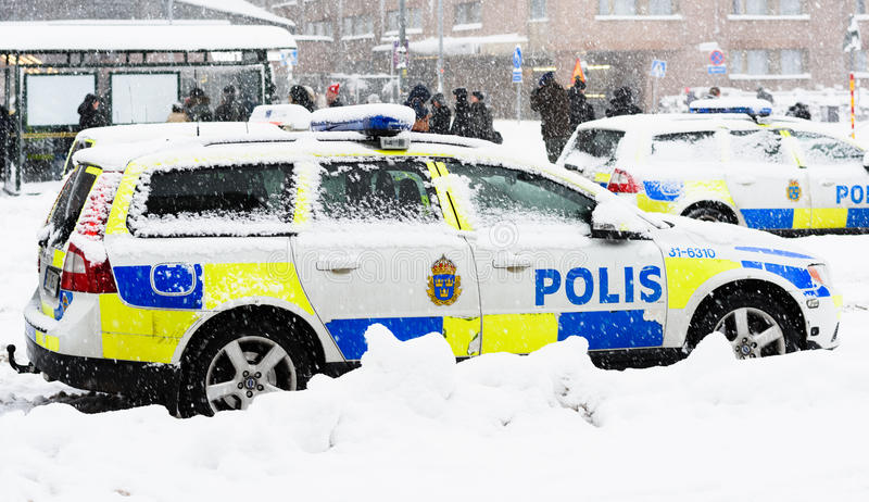 Swedish Police cars parked a winter day. Stockholm, Sweden - November 9, 2016: Swedish Police cars parked a winter day when it is snowing outside the main train royalty free stock photography