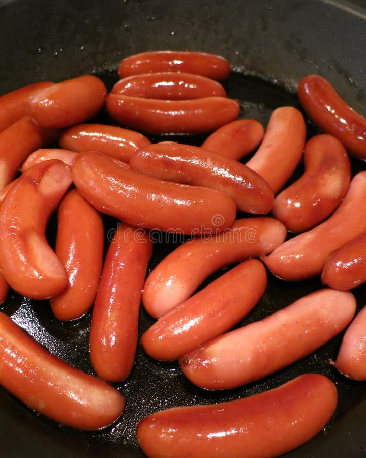 Small sausages for Christmas evening are waiting to be served at the evening dinner for the family and the gests stock photography