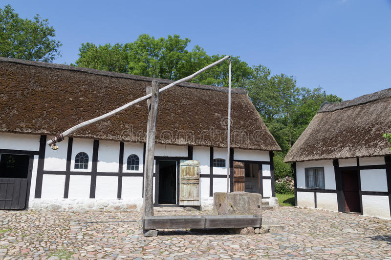 Sweep well in courtyard of old danish farmhouse royalty free stock images