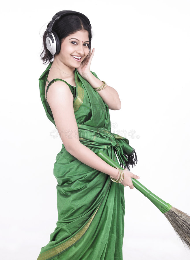 Download Sweeper listening to music stock photo. Image of domestic - 7332540