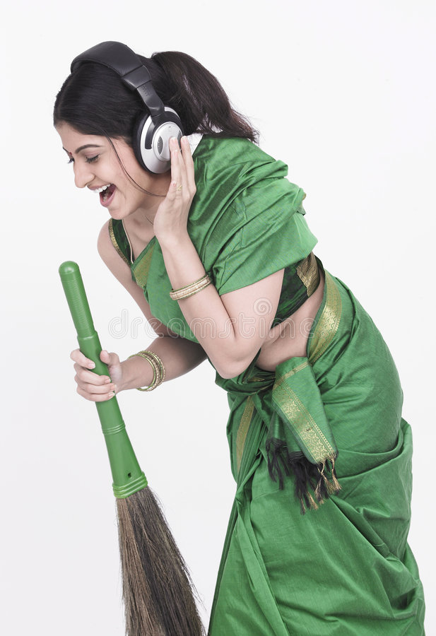 Download Sweeper Singing Into Her Broom Stock Image - Image: 7332617