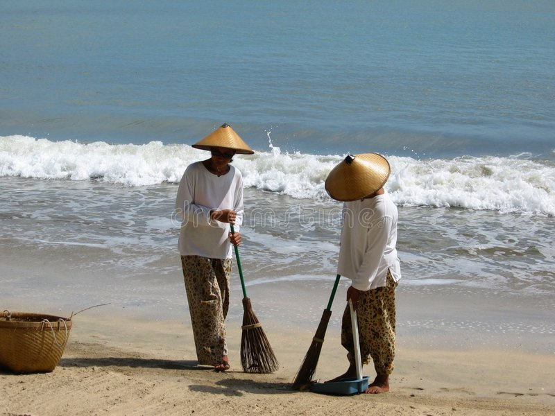Sweepers on Bali royalty free stock images