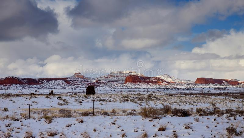 Sweeping clouds in a sky over a mountain rock in New Mexico winter landscape. Clouds in a sky over a mountain rock in New Mexico winter landscape royalty free stock images