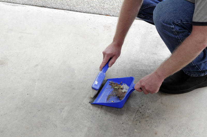 Download Sweeping Floor Dirt Into A Dustpan Stock Photo - Image of cement, human: 91108022