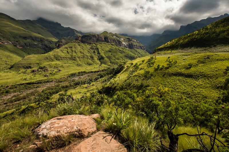 Sweeping mountain sides and cliff faces on the Thukela hike to the bottom of the Amphitheatre`s Tugela Falls in the Royal Natal. National Park, Drakensberg stock photo