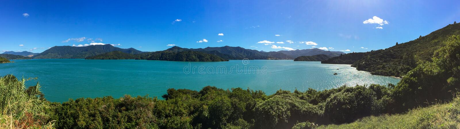 A sweeping panoramic view of the beautiful Marlbough Sounds, New Zealand, sparkling waters, clear blue skies stock photos