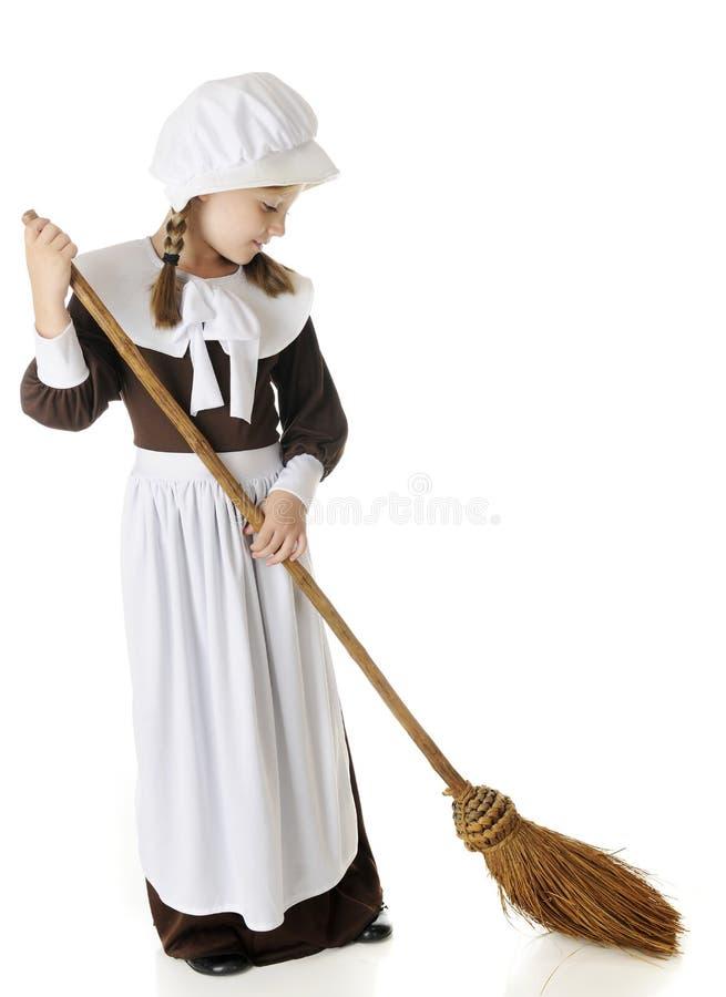 Sweeping Pilgrim Girl stock photo