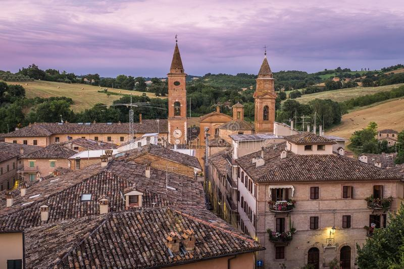 A sweeping view across the roof tops of the small and beautiful Italian town of Caldarola, Le Marche, at sunset. A sweeping view across the roof tops to the royalty free stock photos