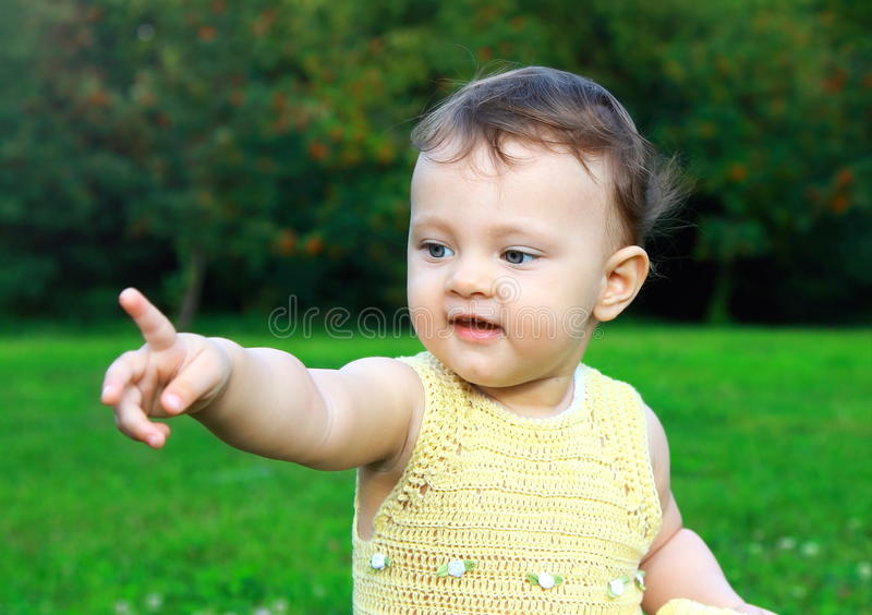 Sweet adorable baby girl showing royalty free stock image