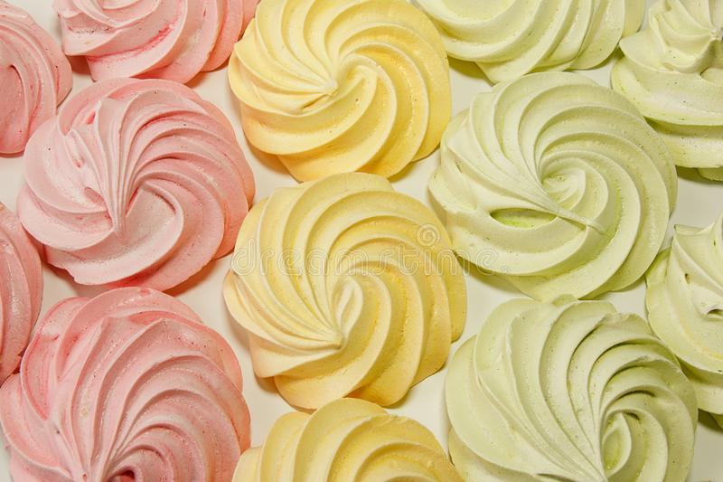 Meringues on a white background stock photography