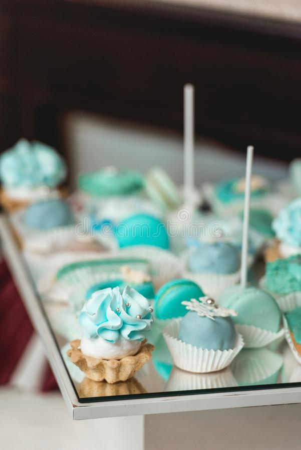 Sweet almond colorful tiffany colored blue macaron or macaroon dessert cake. French sweet cookie. Minimal food bakery concept stock photos