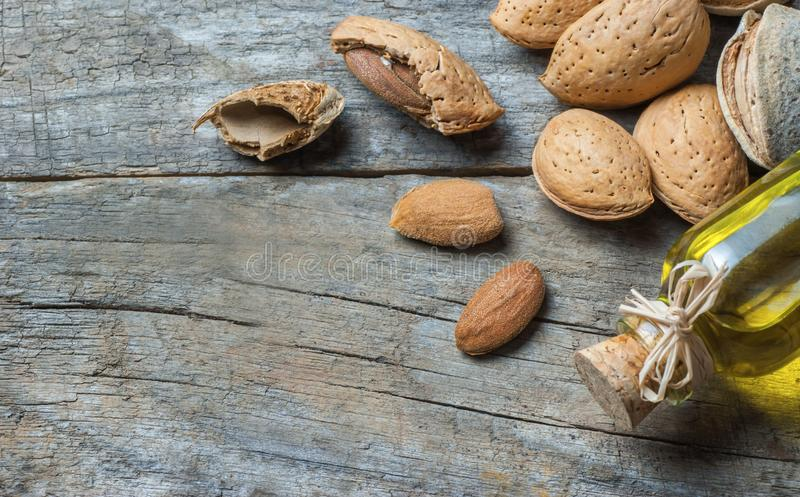 Sweet Almond oil in glass of bottle. Almonds nuts and oil concept. Great for skin health.Almond in nutshell. Organic herbal medicine for many diseases. Prunus stock images