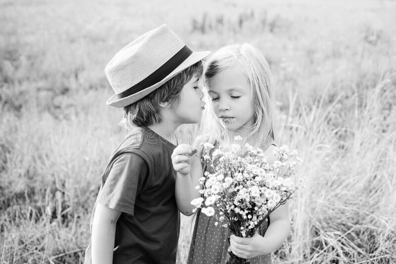 Sweet angel children. Valentines day cupid child. Valentines day card. Child care. Kids having fun in field against stock photo